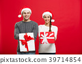 Christmas Concept - Young attractive couple giving 39714854