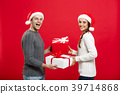 Christmas Concept - Young attractive couple giving 39714868