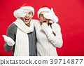Christmas Concept - Young happy stylish couple in 39714877