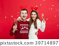 Christmas Concept - Happy caucasian man and woman 39714897