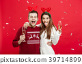 Christmas Concept - Happy caucasian man and woman 39714899