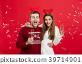 Christmas Concept - Happy caucasian man and woman 39714901