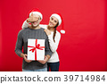 Christmas Concept - Young woman covering man's 39714984