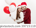 Christmas Concept - Young girlfriend holding 39715110