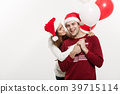Christmas Concept - Young girlfriend holding 39715114