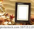 Picture frame on shells and sand background 39715119