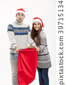 Chirstmas concept - young attractive couple with 39715134
