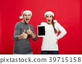 Christmas concept - Happy young couple in sweaters 39715158