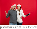 Christmas concept - Happy young couple in 39715179