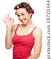 Woman is showing OK sign 39720344