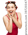 Woman is holding her face in astonishment 39720347