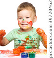 Little boy is playing with paints 39720462