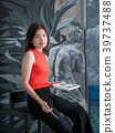 Asian woman artist with her painting 39737488