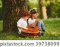 boy and girl playing guitar in summer park 39738099