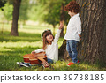 boy and girl playing guitar in summer park 39738185