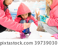asian child girl wear pink jacket play with snow 39739030