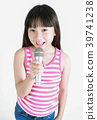 Asian pretty little girl singing with microphone 39741238