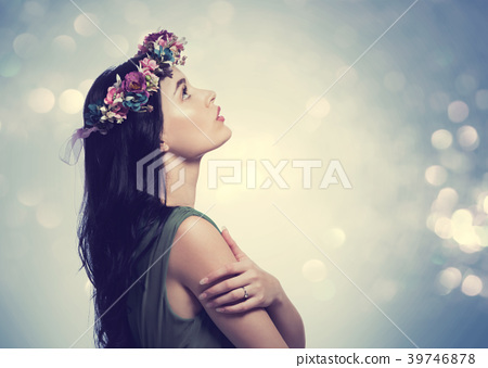 Beautiful young woman with a garland 39746878