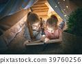 children are reading a book 39760256