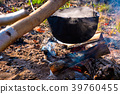 cauldron in steam and smoke on open fire 39760455