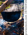 cauldron in steam and smoke on open fire 39760456