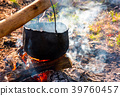 cauldron in steam and smoke on open fire 39760457