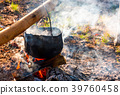 cauldron in steam and smoke on open fire 39760458