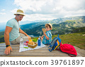Family on a picnic in the mountains 39761897