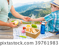 Family on a picnic in the mountains 39761983