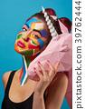 Pop art portrait of model wearing colorful figures 39762444
