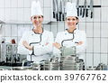 Chefs wearing working clothes in industrial 39767762