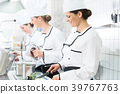 Chefs preparing meals in commercial kitchen 39767763