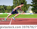 Athlete on cinder track of sports facility starts 39767827
