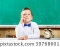 School boy with alarm clock awaiting for lesson 39768601