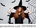 Halloween Concept - Beautiful serious witch with 39769809