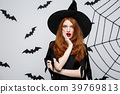 Halloween Concept - Beautiful caucasian witch 39769813