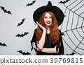 Halloween Concept - Beautiful caucasian witch 39769815