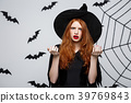 Halloween Concept - Beautiful caucasian witch 39769843