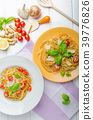 Lemon pasta with cherry tomatoes, basil and nuts 39776826