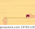 Hands tape measuring on wood background 39782128