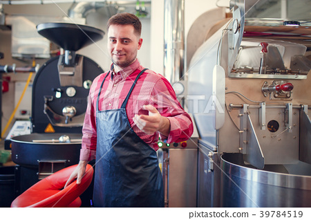 Image of happy man in apron on background of 39784519