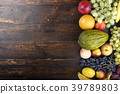 exotic fruits on a wooden background 39789803