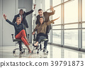 Outgoing employees riding on chairs during job 39791873