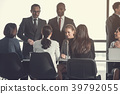 Focused partners talking at work 39792055