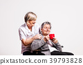 Studio portrait of a senior woman in wheelchair 39793828
