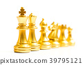 Gold chess piece stand in a row 39795121