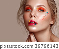 Beautiful girl with art make-up and flowers 39796143