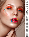 Beautiful girl with art make-up and flowers 39796147