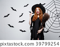 Halloween Concept - Happy elegant witch with 39799254