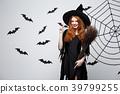 Halloween Concept - Happy elegant witch with 39799255